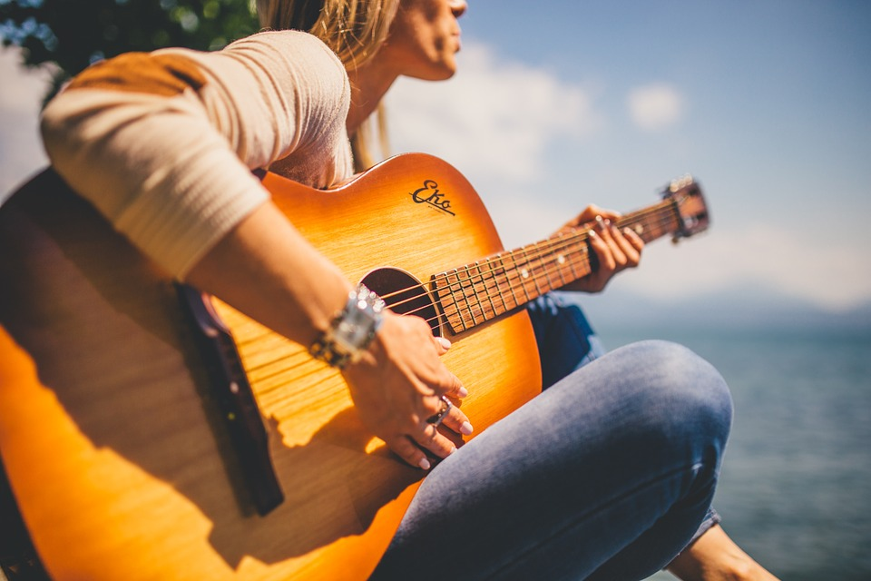 girl holding a guitar