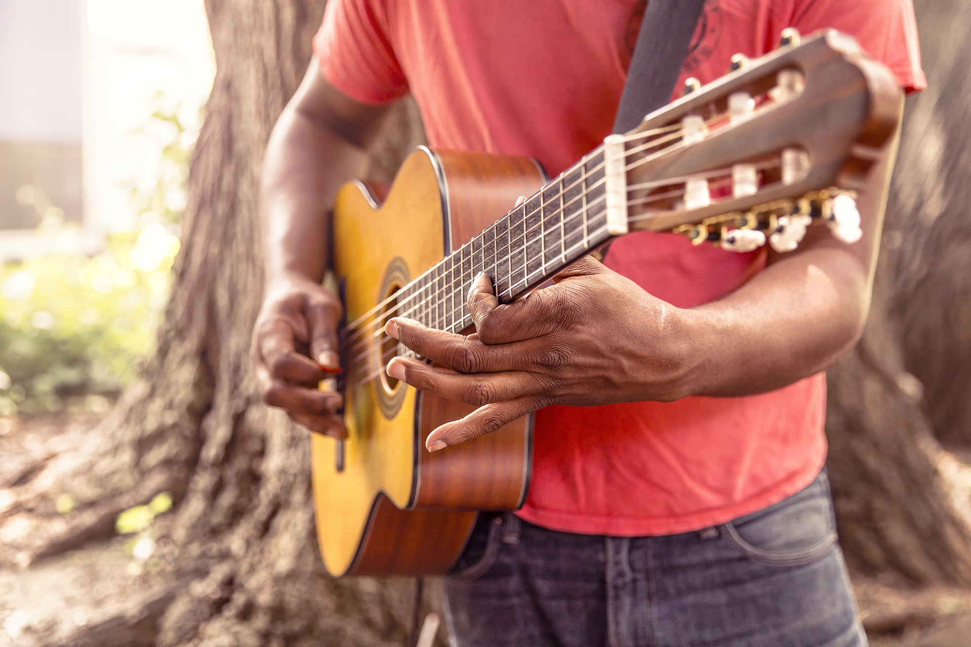 man using a guitar